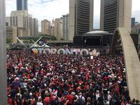 The scene at Nathan Phillips Square while the crowd waits for the parade to arrive