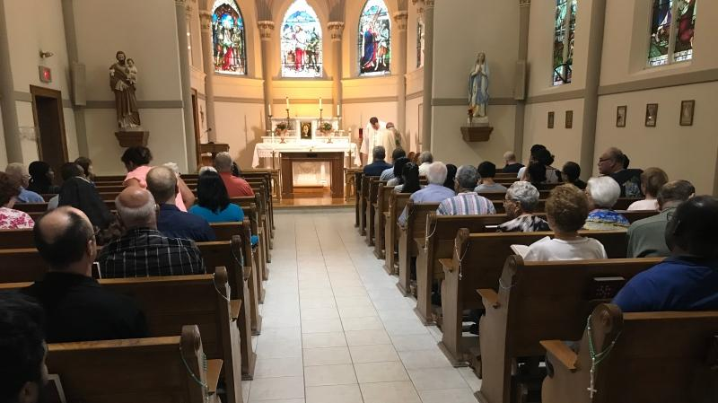 Congregants are gathered at historic Assumption Church in Windsor, Ont., on Thursday, Aug. 15, 2019. (Rich Garton / CTV Windsor)