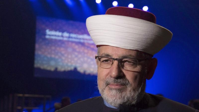 Imam Hassan Guillet arrives at a gathering at the Pavillon de la Jeunesse, marking the first anniversary of the mosque shooting, Sunday, January 28, 2018 in Quebec City. THE CANADIAN PRESS/Jacques Boissinot
