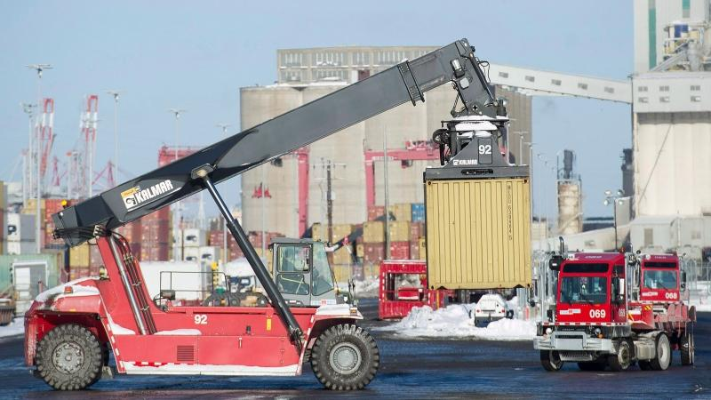 Trucks unload containers from cargo ships in the Port of Montreal, Monday, January 4, 2016. (THE CANADIAN PRESS / Graham Hughes)
