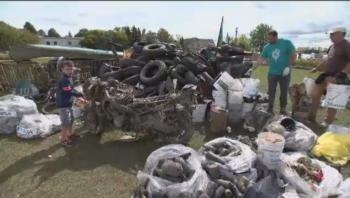 Divers collected four tons of garbage from the bottom of the St. Lawrence River near Lachine Sunday, as the city hopes to reopen beaches.